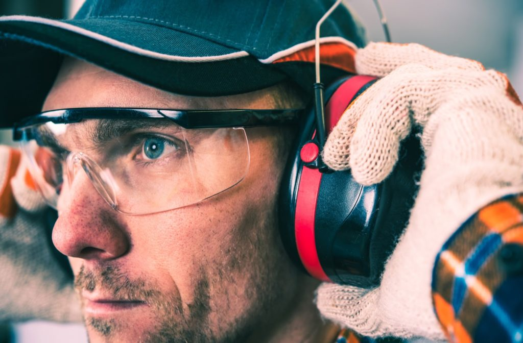 A close up of a trades worker wearing protective eyewear