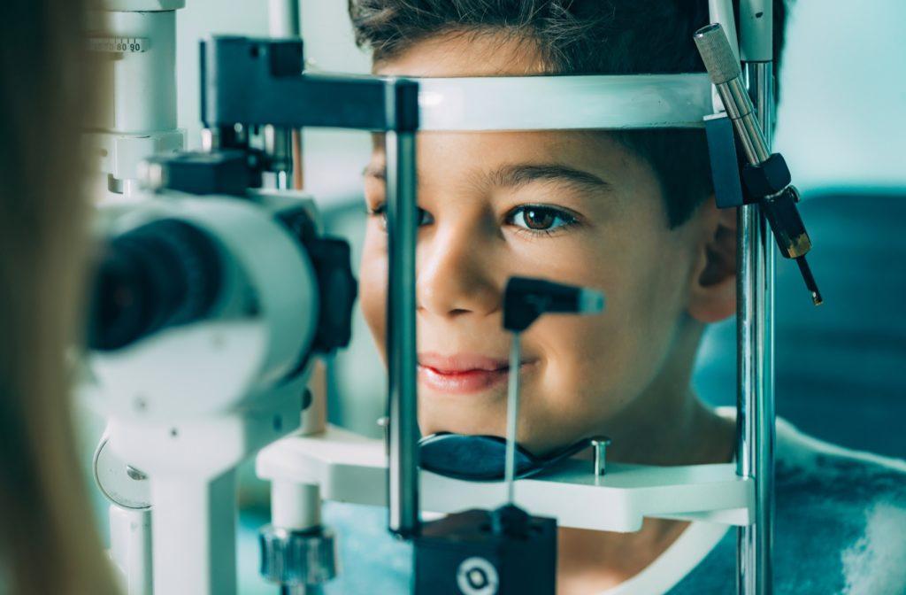 A boy at the optometrists receiving an eye exam