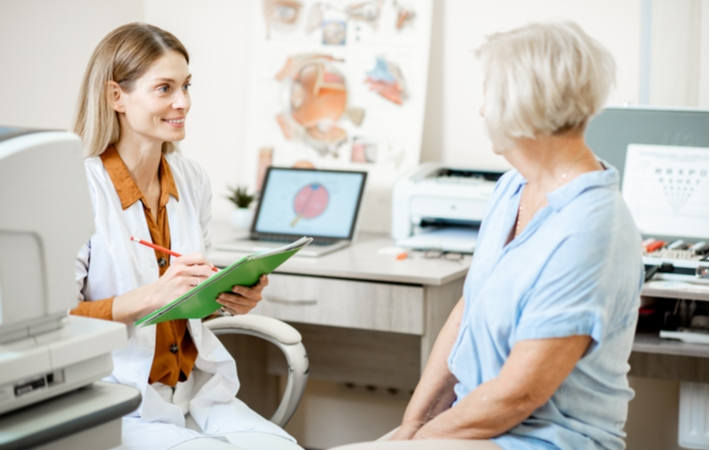 A woman discussing her visual field test results with her optometrist
