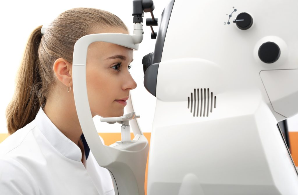 A woman completing a visual field test to help spot possible eye problems